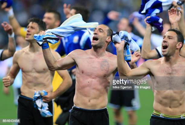 Argentina's Pablo Zabaleta celebrates victory in the penalty shootout with teammates following the FIFA World Cup Semi Final at the Arena de Sao...