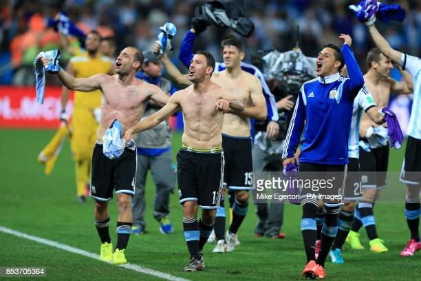 Argentina's Pablo Zabaleta Maxi Rodriguez and Enzo Perez celebrate victory after the penalty shootout