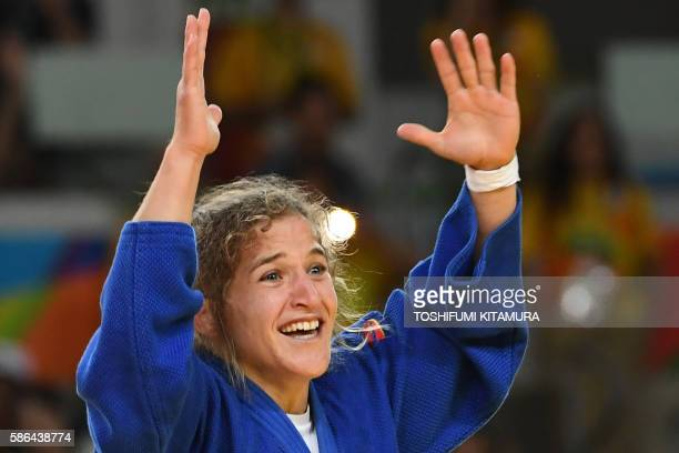 Argentina's Paula Pareto celebrates after defeating South Korea's Jeong Bokyeong during their women's 48kg judo contest gold medal match of the Rio...