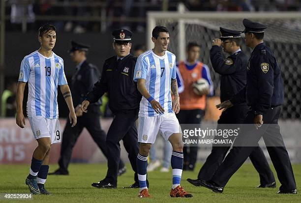 Argentina's Paulo Dybala and Angel Di Maria leave the field at the end of their Russia 2018 FIFA World Cup South American Qualifiers football match...