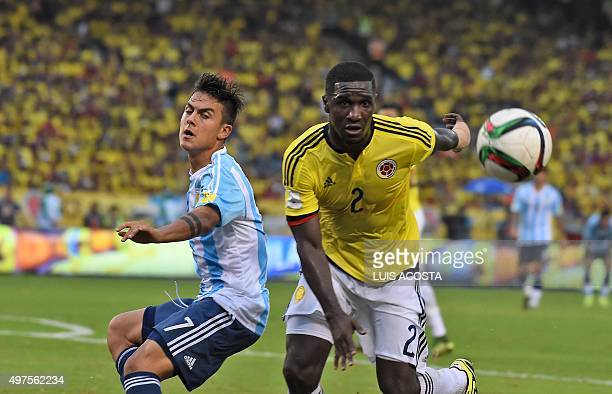 Argentina's Paulo Dybala and Colombia's Cristian Zapata vie for the ball during their Russia 2018 FIFA World Cup South American Qualifiers football...