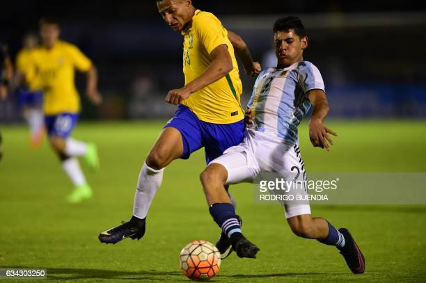 Argentina's player Cristian Romero vies for the ball with Brazil's player Richarlison during their South American Championship U20 football match at...