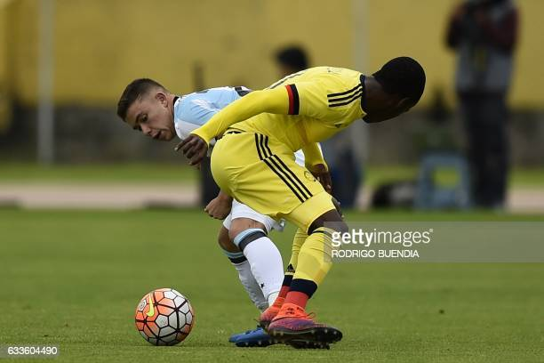 Argentina's player Ezequiel Barco vies for the ball with Colombia's Ever Valencia during their South American Championship U20 football match in the...