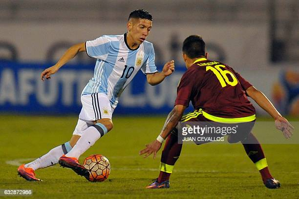 Argentina`s player Ezequiel Barco vies for the ball with Venezuela`s player Ronaldo Lucena during their South American Championship U20 football...