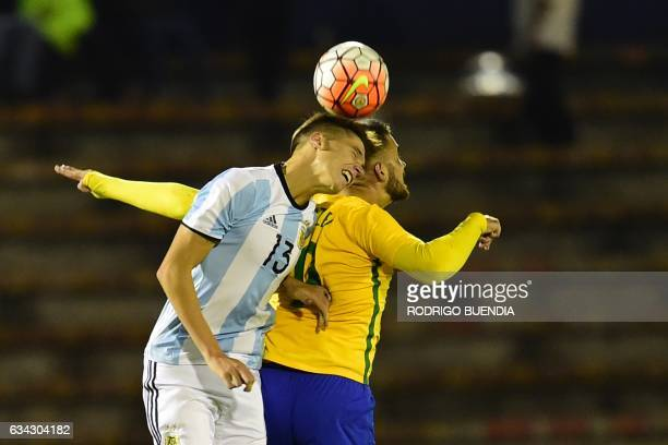 Argentina's player Juan Foyth vies for the ball with Brazil's player Lautaro Martinez during their South American Championship U20 football match in...