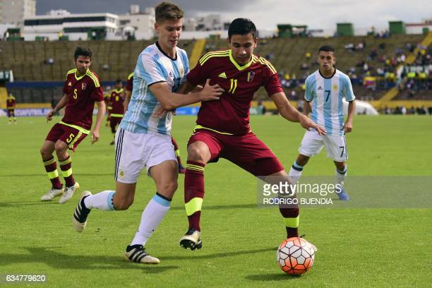 Argentina's player Juan Foyth vies for the ball with Venezuela's Ronaldo Chacon during their South American Championship U20 football match at the...