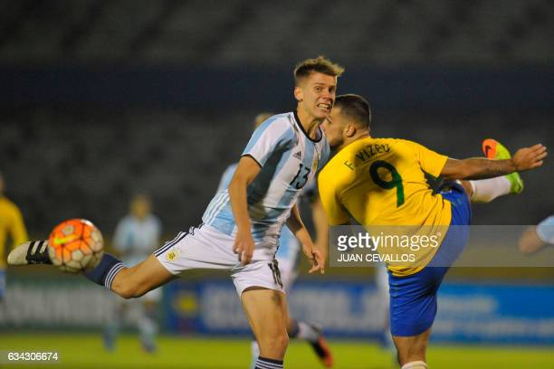 Argentina's player Juan Marcos Foyth vies for the ball with Brazil's player Felipe Vizeu during their U20 South American Championship football match...