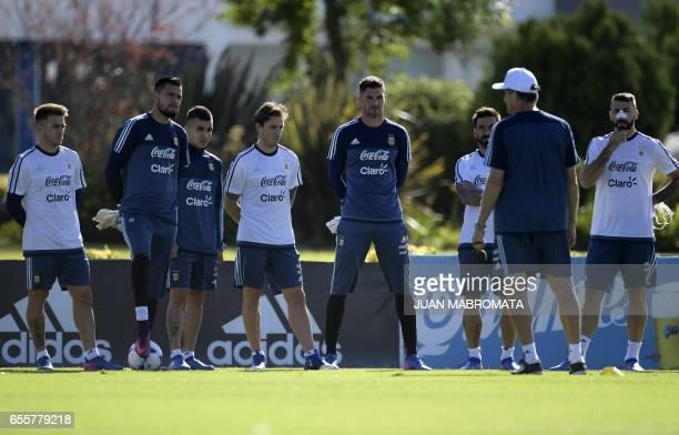 Argentina's player Julio Buffarini goalkeeper Sergio Romero players Angel Correa and Lucas Biglia goalkeeper Mariano Andujar and players Ezequiel...