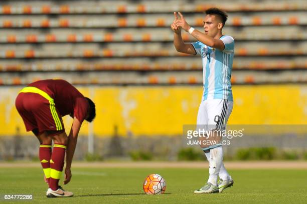 Argentina's player Lautaro Martinez celebrates a goal against Venezuela during their South American Championship U20 football match at the Olimpico...
