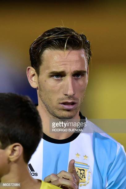 Argentina's player Lucas Biglia poses for pictures before the start of their 2018 World Cup qualifier football match against Ecuador in Quito on...