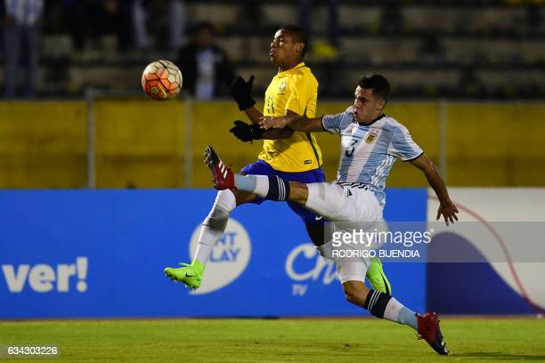 Argentina's player Milton Valenzuela vies for the ball with Brazil's player David Neres during their South American Championship U20 football match...
