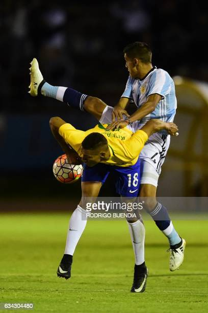Argentina's player Nahuel Molina Lucero vies for the ball with Brazil's player Richarlison during their U20 South American Championship football...