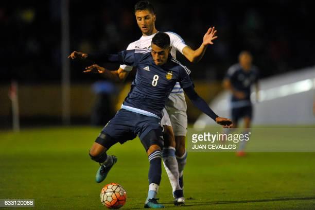Argentina's player Pedro Emmanuel Ojeda vies for the ball with Uruguay's player Rodrigo Bentancur during their South American Championship U20...
