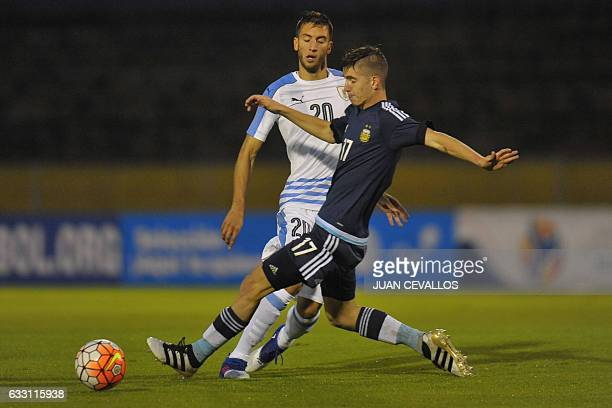 Argentina's player Tomas Belmonte vies for the ball with Uruguay's player Rodrigo Bentancur during their South American Championship U20 football...