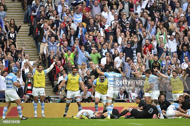 Argentina's players celebrate as their lock Guido Petti Pagadizabal scores a try during a Pool C match of the 2015 Rugby World Cup between New...