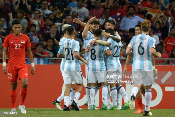 Argentina's players celebrate scoring during the international friendly football match between Singapore and Argentina at the national stadium in...