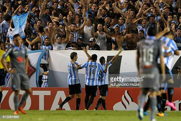 Argentina's players Leandro Grimi Roger Martinez and Lisandro Lopez celebrate after scoring against Bolivia's Bolivar during the Copa Libertadores...
