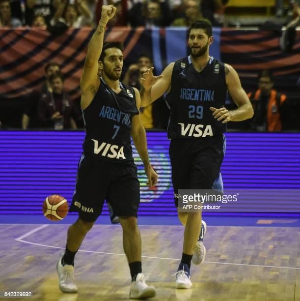 Argentina's point guard Facundo Campazzo celebrates next to teammte small forward Patricio Garino after scoring against the USA during their 2017...