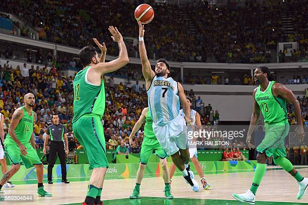 TOPSHOT Argentina's point guard Facundo Campazzo goes to the basket in the last seconds of a Men's round Group B basketball match between Argentina...