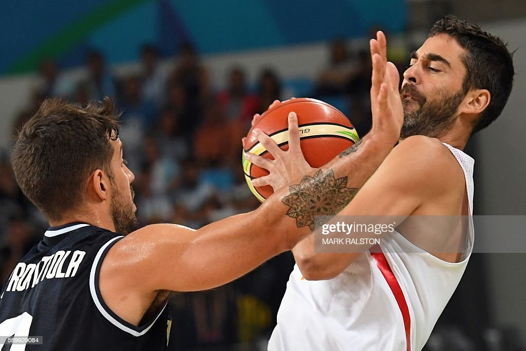 Argentina's point guard Nicolas Laprovittola holds off Spain's guard JuanCarlos Navarro during a Men's round Group B basketball match between Spain...