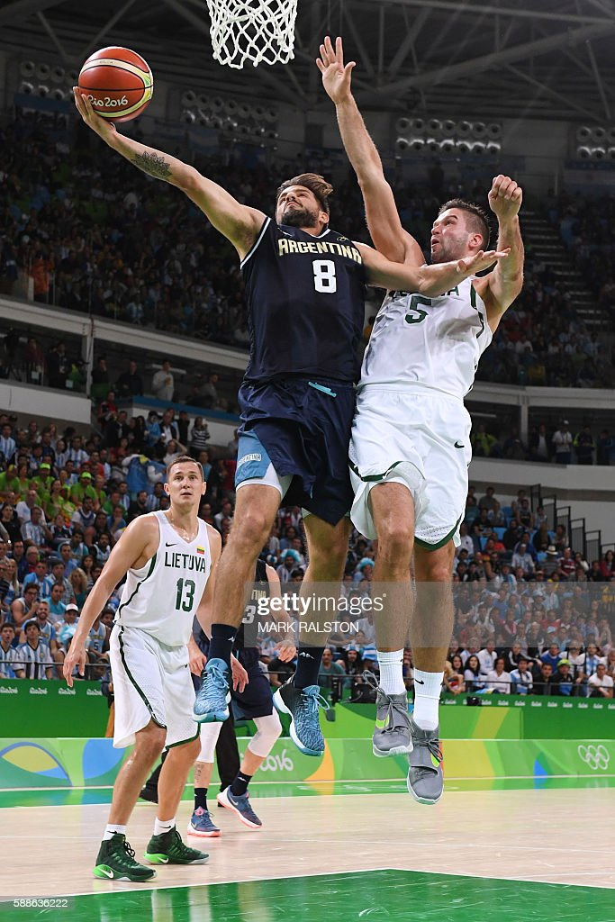 Argentina's point guard Nicolas Laprovittola jumps for a basket Lithuania's guard Mantas Kalnietis during a Men's round Group B basketball match...