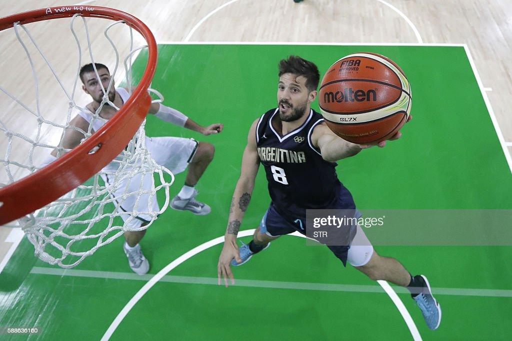 Argentina's point guard Nicolas Laprovittola scores during a Men's round Group B basketball match between Lithuania and Argentina at the Carioca...