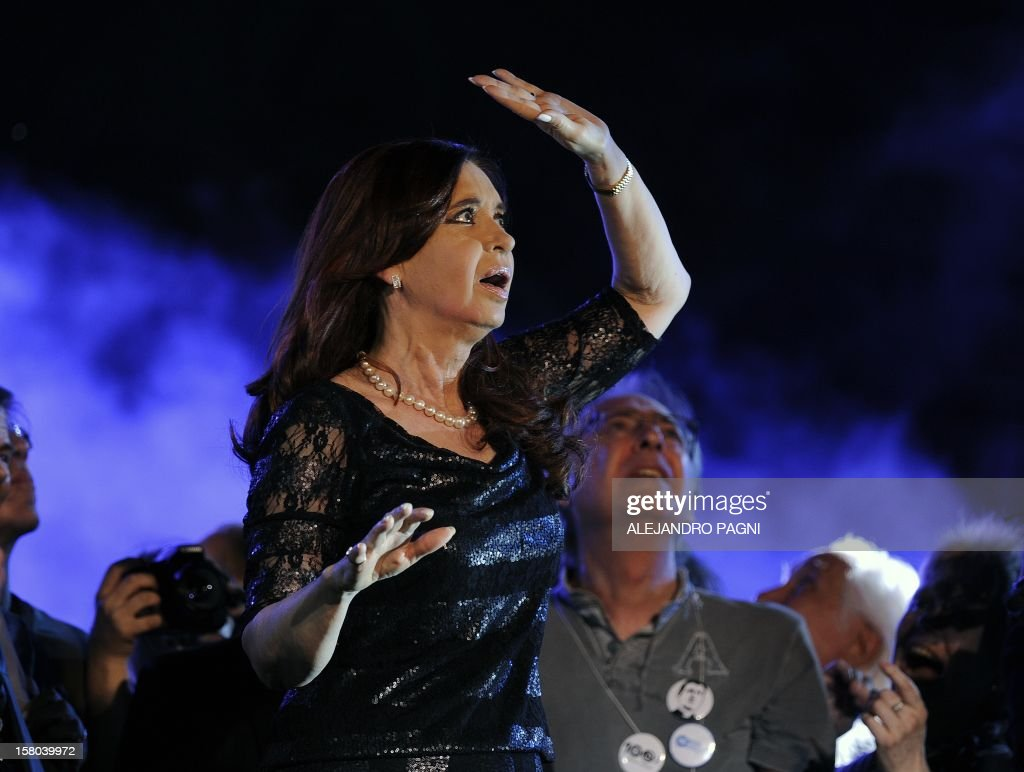 Argentina's President Cristina Fernandez de Kirchner gestures during a perfomance of the Argentinian acrobatic theater group Fuerza Bruta, at Plaza de Mayo, on December 9, 2012, during a rally on the eve of the Day of Democracy and Human Rights, called by the government to celebrate the 29th anniversary of the return to democracy in Argentina. AFP PHOTO / Alejandro PAGNI