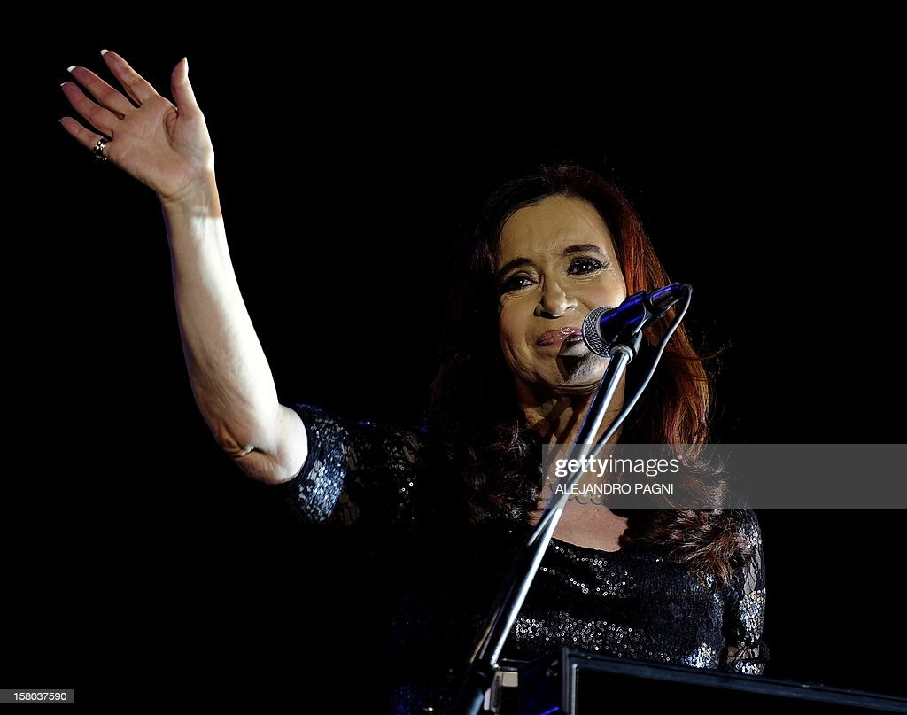 Argentina's President Cristina Fernandez de Kirchner waves to supporters at Plaza de Mayo, on December 9, 2012, during a rally called by the government to celebrate the 29th anniversary of the return to democracy in Argentina, on the eve of the Day of Democracy and Human Rights. AFP PHOTO / Alejandro PAGNI