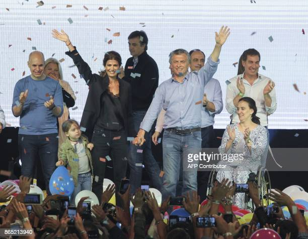 Argentina's President Mauricio Macri and his wife the first lady Juliana Awada wave next to their daughter Antonia Argentina's VicePresident Gabriela...