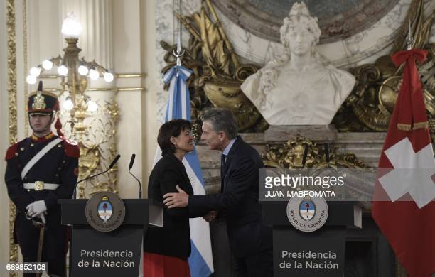 Argentina's President Mauricio Macri and Switzerland's President Doris Leuthard greet each other during a joint conference after holding a working...