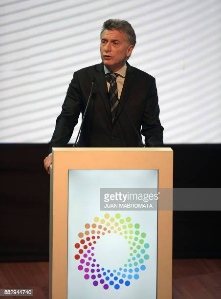 Argentina's President Mauricio Macri delivers a speech during the launching ceremony of the G20 Argentina's presidency in Buenos Aires on November 30...