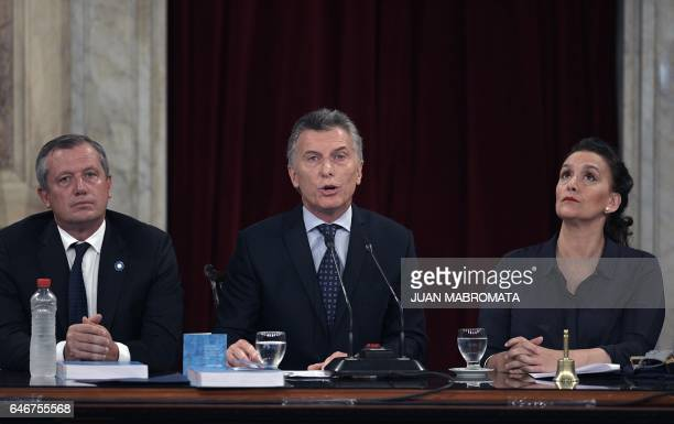 Argentina's President Mauricio Macri delivers a speech next to VicePresident Gabriela Michetti and deputy Emilio Monzo during the inauguration of the...