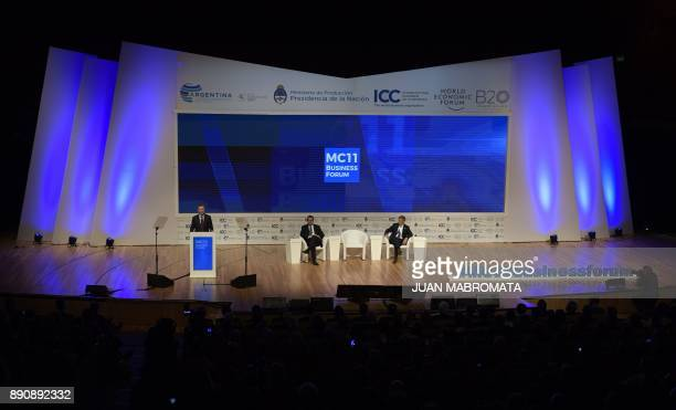 Argentina's President Mauricio Macri delivers a speech next to the director general of the World Trade Organization Roberto Azevedo and Argentina's...