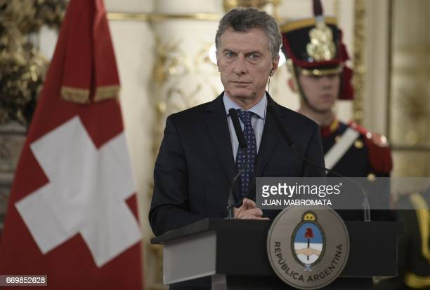 Argentina's President Mauricio Macri listens during a joint press conference with Switzerland's President Doris Leuthard after holding a working...