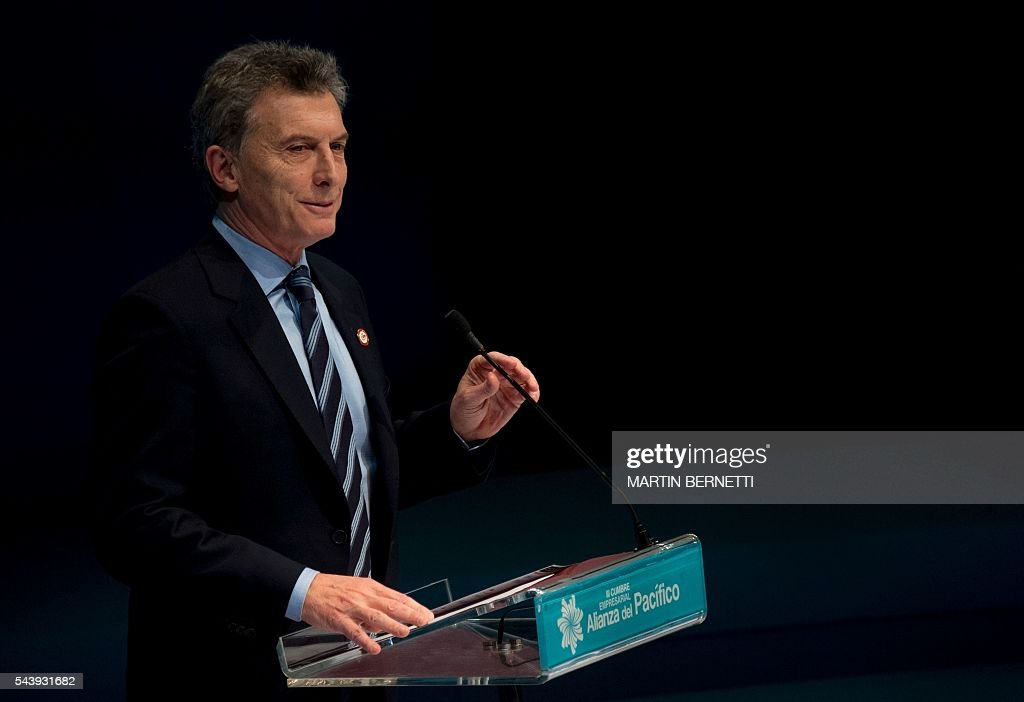 Argentina's president Mauricio Macri speaks during a III Pacific Alliance Business Summit in Frutillar, 1.100 km south of Santiago, Chile, June 30,2016. / AFP / MARTIN