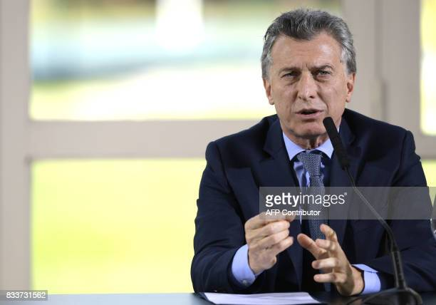 Argentina's President Mauricio Macri talks to the media next to the World Bank President Jim Yong Kim during a press conference after a working...