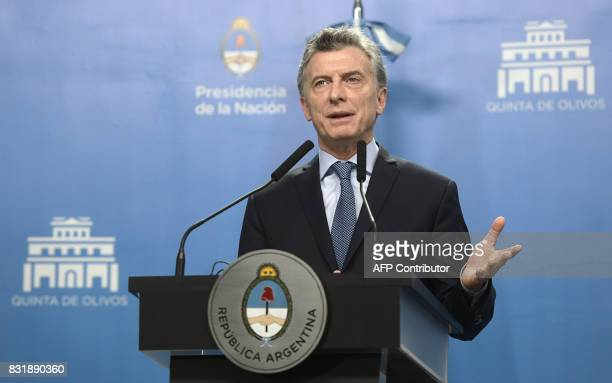 Argentina's President Mauricio Macri talks to the media next to US Vice President Mike Pence during a press conference after a working meeting at the...