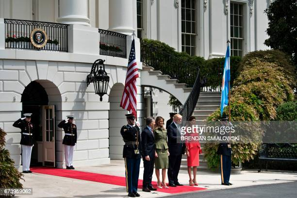Argentina's President Mauricio Macri US First Lady Melania Trump US President Donald Trump and Argentina's First Lady Juliana Awada pose outside the...