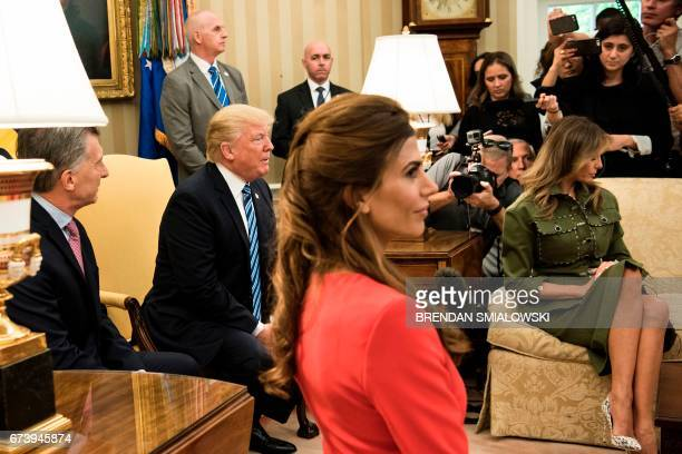 Argentina's President Mauricio Macri US President Donald Trump Argentina's First Lady Juliana Awada and US First Lady Melania Trump wait for a...