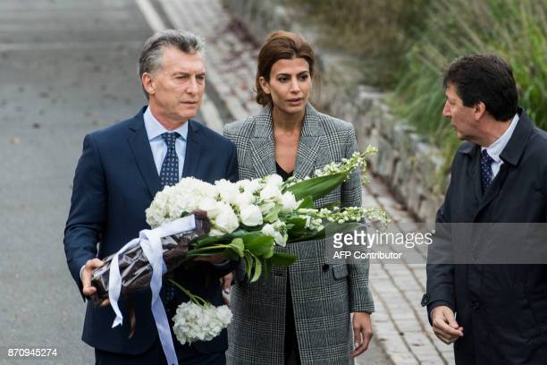 Argentinas Presidnet Mauricio Macri and Frist Lady Juliana Awada arrive to lay a wreath on a bike path during a ceremony in New York on November 6 to...