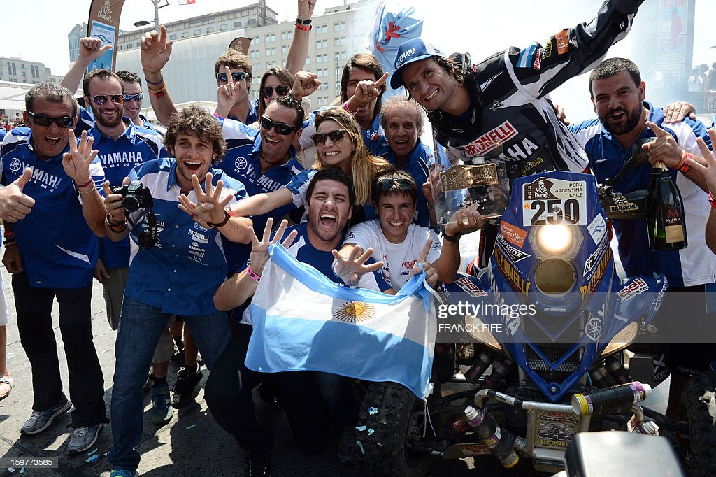 Argentina's quad driver Marcos Patronelli (R) celebrates his first place with his staff members on the podium of the Rally Dakar 2013 in Santiago, Chile on January 20, 2013. Stephane Peterhansel claimed a record fifth Dakar Rally drivers title, and 11th overall of his career, while French compatriot Cyril Despres captured a fifth motorcycling crown.