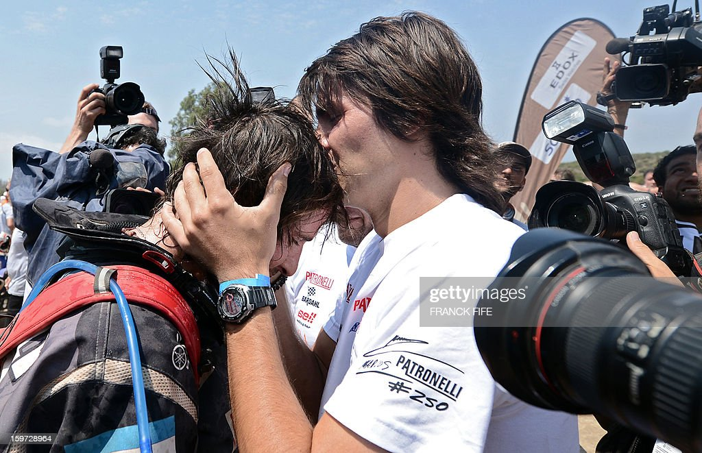 Argentina's quad driver Marcos Patronelli (L) is congratuled by his brother Alejandro Patronelli after the 14th stage of the Dakar 2013, between La Serena and Santiago, Chile on January 19, 2013.