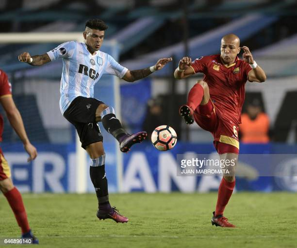 Argentina's Racing Club forward Gustavo Bou vies for the ball with Colombia's Rionegro Aguilas midfielder Juan Ortiz during their Copa Sudamericana...