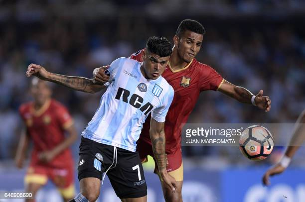 Argentina's Racing Club forward Gustavo Bou vies for the ball with Colombia's Rionegro Aguilas defender Edwin Peraza during their Copa Sudamericana...