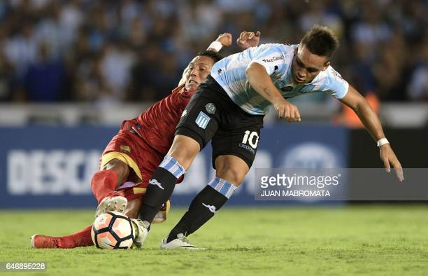 Argentina's Racing Club forward Lautaro Martinez vies for the ball with Colombia's Rionegro Aguilas midfielder John Restrepo during their Copa...
