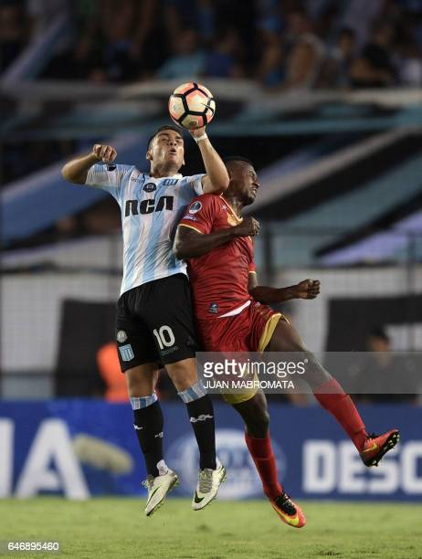 Argentina's Racing Club forward Lautaro Martinez vies for the ball with Colombia's Rionegro Aguilas defender Hanyer Mosquera during their Copa...
