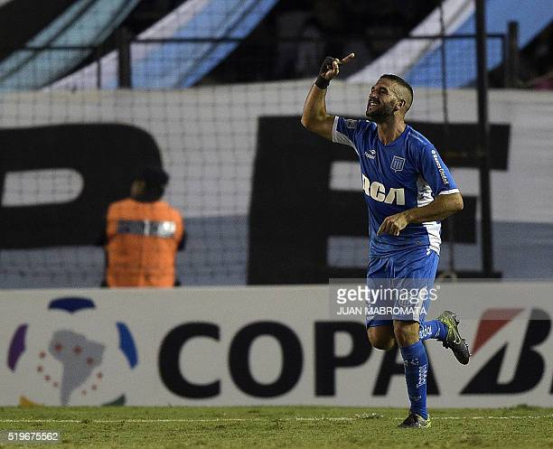 Argentina's Racing Club forward Lisandro Lopez celebrates after scoring the team's second goal against Colombia's Deportivo Cali during the Copa...