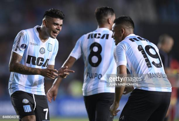 Argentina's Racing Club midfielder Brian Mansilla celebrates with teammate forward Gustavo Bou after scoring against Colombia's Rionegro Aguilas...