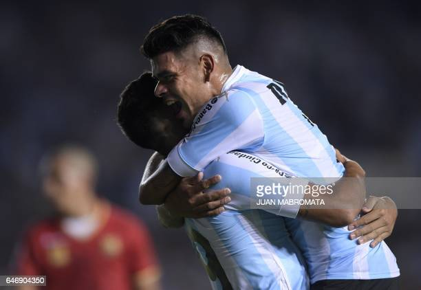 Argentina's Racing Club midfielder Brian Mansilla celebrates with teammate forward Gustavo Bou after scoring a goal against Colombia's Rionegro...