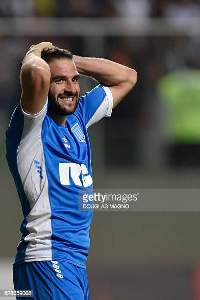Argentina's Racing player Lisandro Lopez gestures during the 2016 Libertadores Cup football match against Brazilian Atletico Mineiro at the...